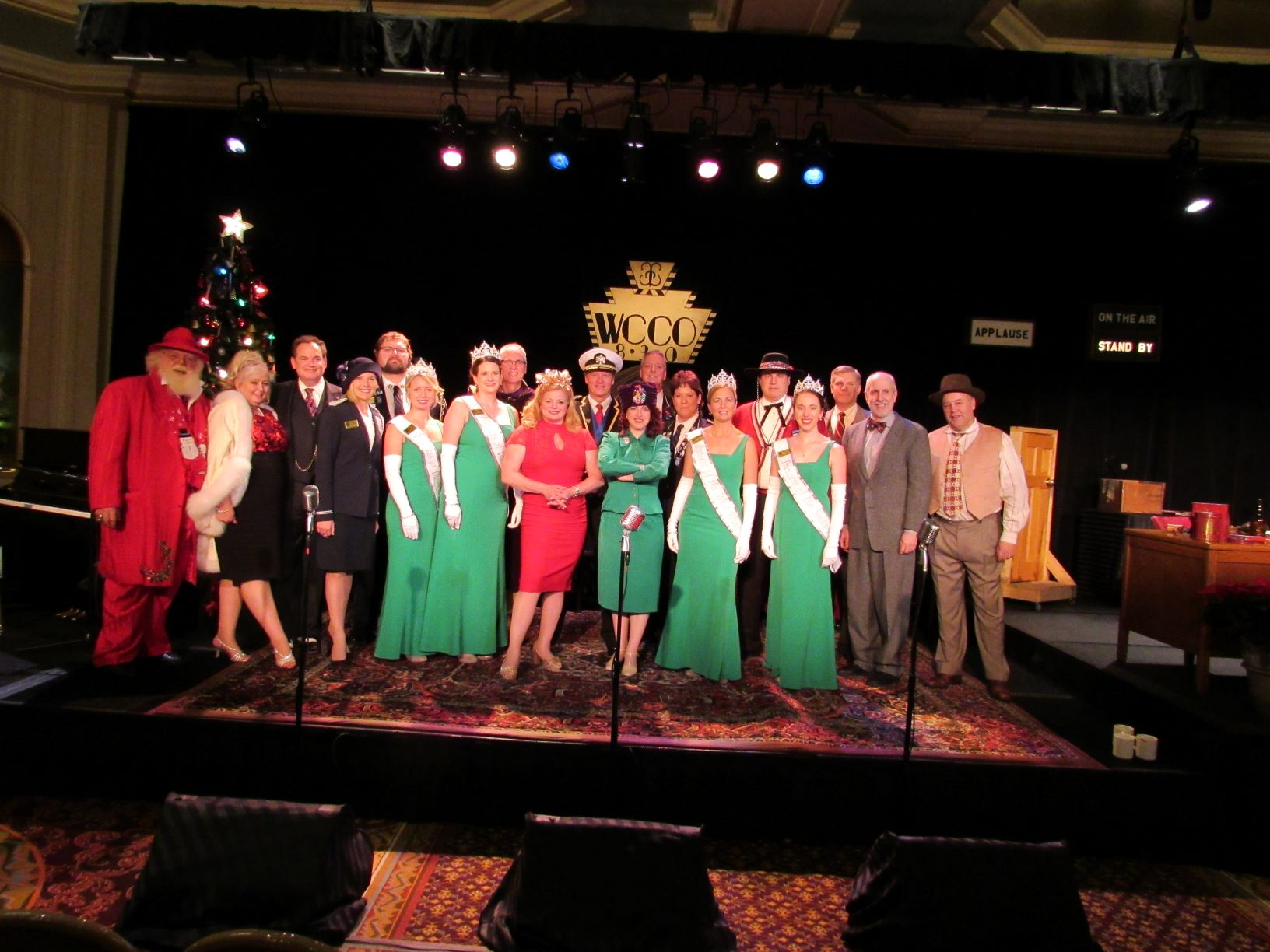 Photo of the cast members of It's A Wonderful Life: A Live Radio Play, St. Paul Winter Carnival Royal Family members and Santa and Mrs. Claus at the Neighbors Benefit Performance Night.