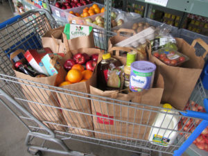 A client's cart full of food from the food shelf.